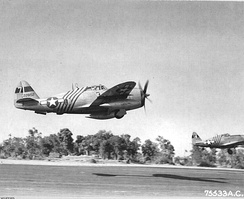 P-47 Thunderbolts of the 1st Air Commando Group, 10th Air Force, taking off. Republic P-47D-23-RA Thunderbolt, AAF Ser. No. 42-28152, in foreground exhibits the diagonal fuselage identification stripes that were unique to 1ACG aircraft.