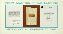 Pieces of fabric and wood from the 1903 Wright Flyer traveled to the Moon in the Apollo 11 lunar module Eagle, and are exhibited at the Wright Brothers National Memorial