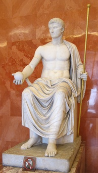 Reconstructed statue of Augustus as Jove, holding scepter and orb (first half of 1st century AD).[185] The Imperial cult of ancient Rome identified emperors and some members of their families with the divinely sanctioned authority (auctoritas) of the Roman State. The rite of apotheosis (also called consecratio) signified the deceased emperor's deification and acknowledged his role as father of the people similar to the concept of a pater familias' soul or manes being honoured by his sons.[186]