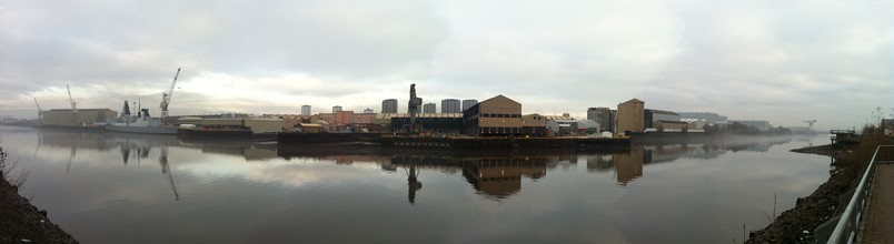 Panoramic view of BAE Systems Scotstoun in December 2010, with HMS Dragon on the left preparing for sea trials.