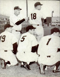"Stengel with some of his players. The uniform numbers spell out ""18"" and ""1951"", signifying the Yankee hopes for an 18th pennant that year"