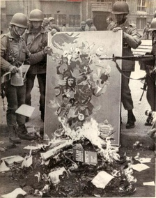 Chilean soldiers burning communist books after the coup d'état 1973)