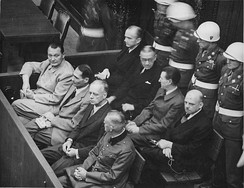 Defendants in the dock at the Nuremberg trials. The main target of the prosecution was Hermann Göring (at the left edge on the first row of benches), considered to be the most important surviving official in the Third Reich after Hitler's death. Göring later committed suicide.