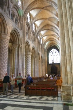 Durham Cathedral, England, has decorated masonry columns alternating with piers of clustered shafts supporting the earliest pointed high ribs.