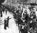French cuirassiers, wearing breastplates and helmets, parade through Paris on the way to battle, August 1914.