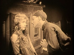 A scene from Broken Blossoms starring Lillian Gish and Richard Barthelmess—an example of a sepia-tinted print.