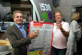 Hans Breukhoven and Lex Harding celebrating a printed edition of the Dutch Top 40 in 2005