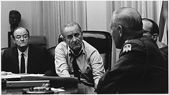 Humphrey (left) and President Lyndon Johnson (center) discuss the Vietnam War.