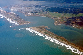 Aerial view of jetties, constructed of dolosse, at Humboldt Bay harbor entrance. These jetties mitigate unpredictable shifting sands.