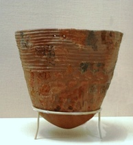 An Incipient Jōmon pottery vessel reconstructed from fragments (10,000–8,000 BC), Tokyo National Museum, Japan