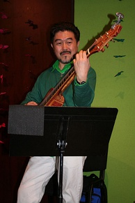 Watanabe performing in 2006