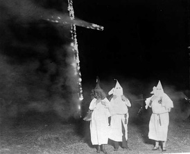 "The KKK and a ""Fiery Cross""; image from the 1920s"