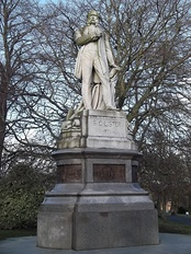 The statue of Lister in Bradford's Lister Park depicts him standing with a two-foot rule clasped across his chest.