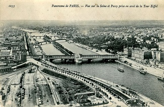 Panorama of Paris, View of la Seine and Passy seen from downstream of the Eiffel Tower. In the foreground, the former Champ de Mars train station, followed by the Pont de Passy. Postcard image taken from the second level of the Eiffel Tower
