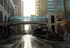 Facing west, previous skywalk over the C-Train tracks linking the downtown Holt Renfrew department store to the 4th Street Southwest LRT station before its reconstruction