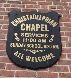 A sign showing the times of service for a Christadelphian ecclesia in Richmond, Va.