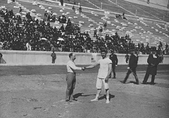 Carl Schuhmann (left) and Georgios Tsitas shake hands before the final match of the wrestling competition