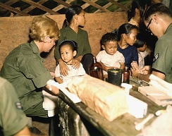 A nurse treats a Vietnamese child, 1967