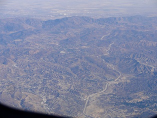 Aerial view of Soledad Canyon, with the Antelope Valley Freeway winding up through it from Santa Clarita toward Palmdale. Agua Dulce is visible in the center of the image, just left of the freeway.