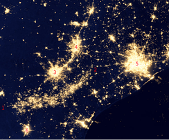 "Eagle Ford Shale flares visible from space (green and  infrared wavelengths), in the arc between ""1"" and ""2"", amid cities in southeast Texas in 2012."