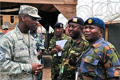 Combined Joint Task Force – Horn of Africa Command Senior Enlisted Leader, U.S. Air Force Chief Master Sgt. James E. Davis, Kenya Air Force Base Sgt. Major Maurice Atsango Matwang'a (right) and Kenya Army Weapons Training Sgt. Major David Karisa Barisa discuss a personnel inspection they just completed.