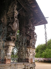 Two pillars with hanging stone chain