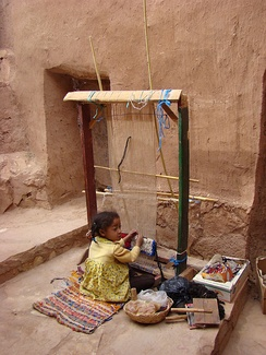Young girl working on a loom in Aït Benhaddou, Morocco in May 2008.