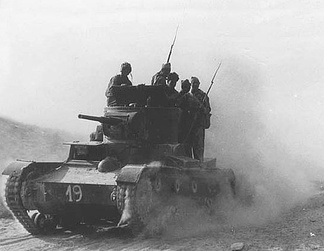 International Brigadiers volunteered on the side of the Republic. The photo shows members of the XI International Brigade on a T-26 tank during the Battle of Belchite (August–September 1937).