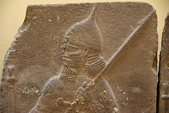 Assyrian soldier holding a spear and wearing a helmet. Detail of a basalt relief from the palace of Tiglath-pileser III at Hadatu, Syria. 744-727 BCE. Ancient Orient Museum, Istanbul