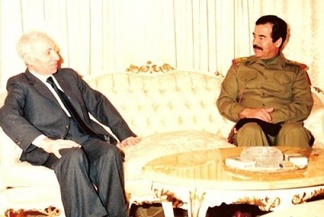 Saddam Hussein (right) talking with Aflaq (left) in 1988.