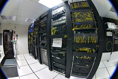 Racks of telecommunications equipment in part of a data center