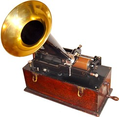 Edison cylinder phonograph c. 1899. The phonograph cylinder is a storage medium. The phonograph may be considered a storage device especially as machines of this vintage were able to record on blank cylinders.