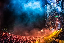 An EDM festival in 2013 in Plainfeld, Austria with over 100,000 attendees,[171] exhibiting the large crowds and dramatic lighting common at such events since the early 2000s.[3]