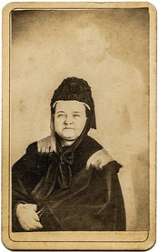 "Mary Todd Lincoln with the ""ghost"" of her husband, in a hoax image created by ""spirit photographer"" William H. Mumler"
