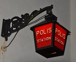 Red sign outside a Swedish police station