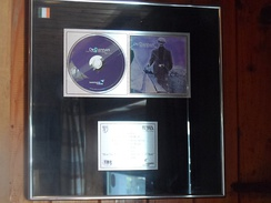 Platinum record awarded to De Dannan by the Irish Recorded Music Association for their 1999 album How the West Was Won. In Ireland, a recording must sell 15,000 units to be certified platinum.