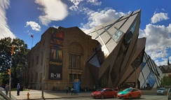 "The Royal Ontario Museum was originally designed in a Romanesque Revival style, although other styles were since been added to the building. Architecture in Toronto has been called a ""mix of periods and styles""."