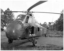 US Army Sikorsky S-58 gunship armed with two M2 .50 caliber machine-guns and twenty-four 2.75-inch rockets