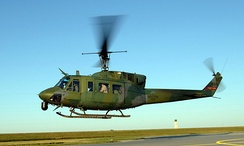 A UH-1N Huey takes off Minot Air Force Base