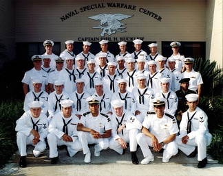 The graduating members of BUD/S Class 236 in front of the Naval Special Warfare Center. At the far left of the back row is Medal of Honor recipient Michael P. Murphy