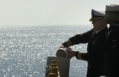 Commander Lee Axtell releases the ashes of Wally Schirra during his burial at sea (2008)