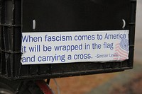 Bumper sticker with a Sinclair Lewis quote on a bicycle