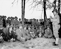 100th Infantry soldiers receiving training in the use of grenades in 1943