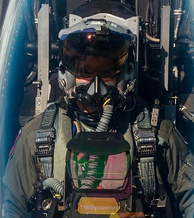 F-16 pilot with Joint Helmet Mounted Cueing System and cockpit head-up display