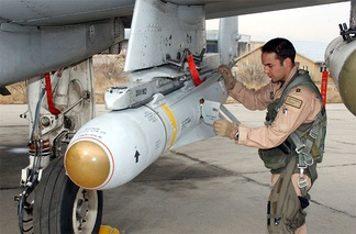 A pilot inspects an AGM-65 Maverick missile on his A-10 Thunderbolt II.
