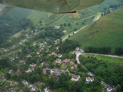 Aerial photo of part of the town in 2008, showing the entrance to Carding Mill Valley and the Golf Club's clubhouse