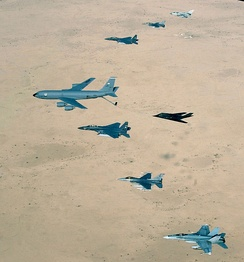 An RAAF F/A-18 with a USAF KC-135 Stratotanker, two F-15Es, an F-117, two F-16s and a RAF Tornado over Iraq