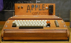 Apple's first product, the Apple I, designed by Steve Wozniak, was sold as an assembled circuit board and lacked basic features such as a keyboard, monitor, and case. The owner of this unit added a keyboard and wooden case.