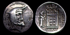 Coin of Vadfradad I (Autophradates I). The picture behind the coin is a structure similar to Ka'ba-ye Zartosht.[16]