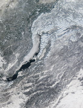 Lake Baikal. Lake ice is beginning to form at the northernmost end of the lake and in a bay at the middle.